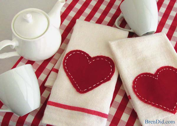 "Saying ""I love you!"" doesn't have to cost a bundle this Valentine's Day. Impress your guests with these adorable Valentine Tea Towels {Pottery Barn inspired} for only $0.79! Read the easy tutorial with free printable pattern at BrenDid.com. The easy craft uses premade flour sack tea towels and iron-on adhesive appliqué. The best part, at under $1 each you can afford to spread the Valentine love around the whole neighborhood! - See more at: https://brendid.com/pb-inspired-valentine-tea-towels/"