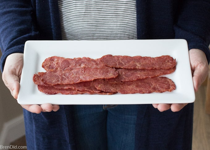 turkey bacon on platter in women's hands