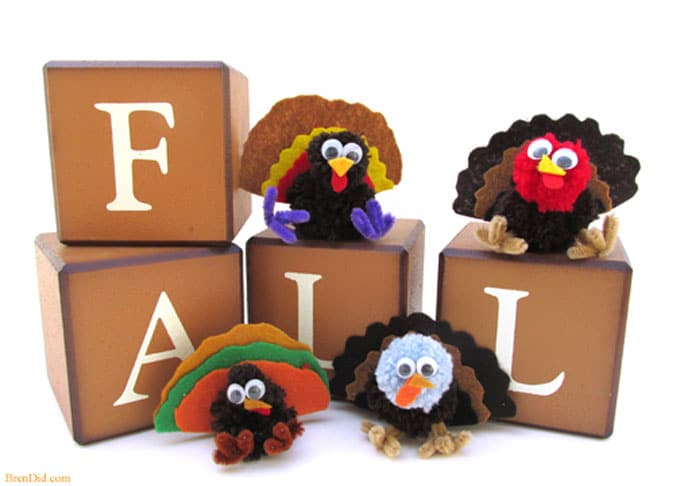 Thanksgiving kid crafts - making yarn pom pom turkeys and Free Birds on Netflix