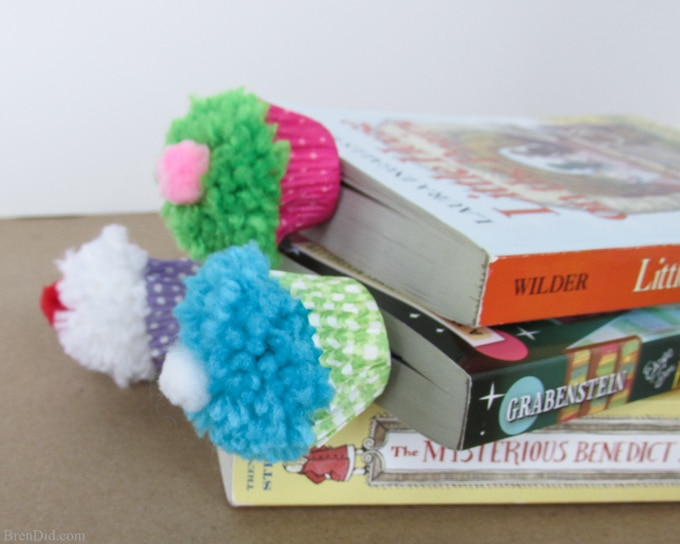 Cupcake Bookmark Craft and Free Printable Valentine Cards from BrenDid -Learn to make pom poms into cute cupcake bookmarks. Easy kids' craft for Valentine's Day gifts and cards.