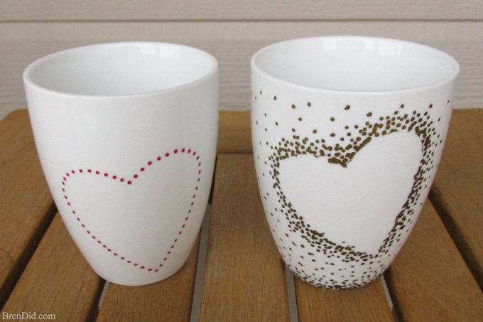 DIY Craft Project: Sharpie Mug Tutorial - Custom heart handle mugs that require no artistic ability or transfers! If you can trace and make dots you can make these mugs! Learn the easy hack! Uses oil based Sharpie paint pens that are baked on.