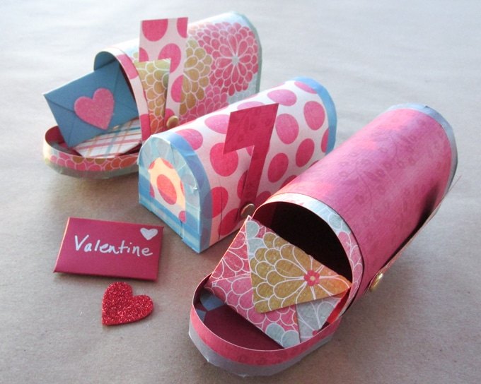 Send the sweetest love notes with this Valentine Paper Craft set featuring a free printable mailbox and mini Valentine's Day cards. It's an easy Valentine craft that can be used to hold sweets or just sweet sentiments! Get the free printable pattern and instructions at BrenDid.com.