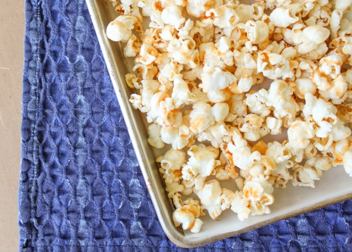 Sriracha Honey Caramel Popcorn is an easy to make sweet and spicy snack that will take your snack break up a notch. It is a pleasing mixture of spicy with sweet that brings out the best of both flavors.