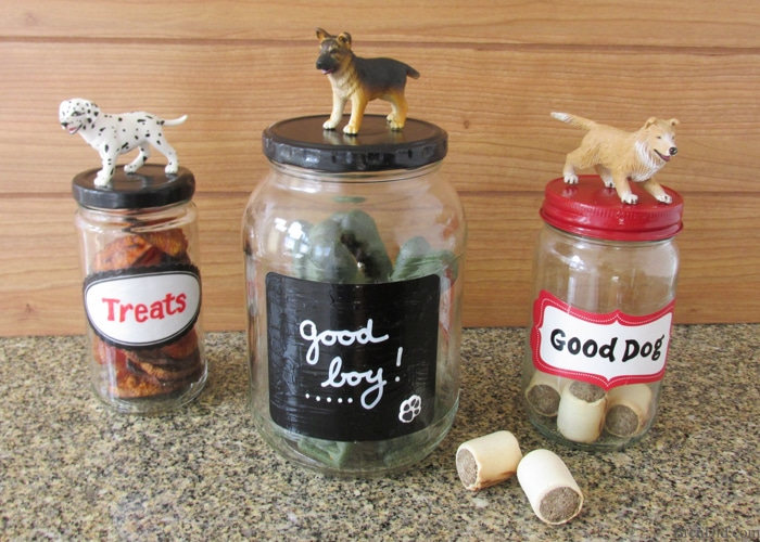 Easy Upcycled Pet Treat Containers - Making craft projects from recycled materials is a great way to save on craft costs while reducing waste. These adorable upcycled pet treat jars reuse glass jars from your kitchen.