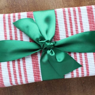 Green your holiday gift giving by making eco-friendly choices when preparing your gift. The holidays can be fun and magical while still being environmentally conscious. Learn 10 easy, frugal, eco-friendly gift wrapping ideas.