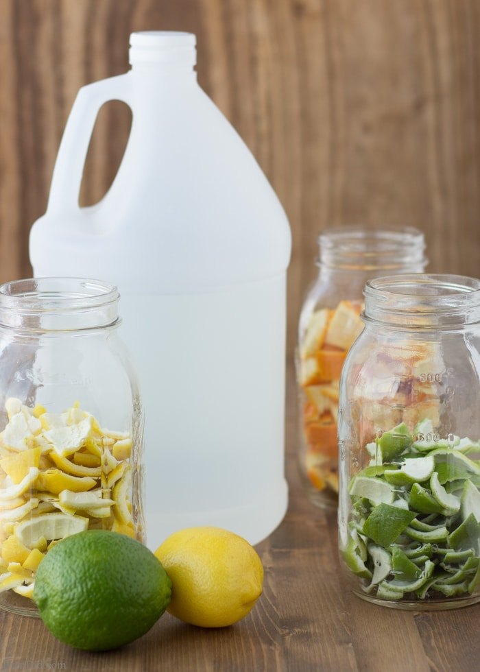 Vinegar for Cleaning with citrus peels in jars