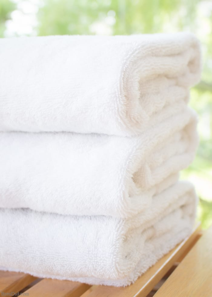 Ever encountered the musty, moldy odor of smelly towels? The less-than-fresh scent is caused by bacteria. Gross but true! Learn how to naturally eliminate laundry room bacteria and keep towels fresh with this green cleaning tutorial.