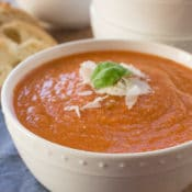 Creamy, comforting, and cheesy this healthy slow cooker tomato basil parmesan soup is packed with vegetables that give it incredible flavor without all the fat and calories. Shhh… no one will know it's anything but delicious creamy tomato soup!