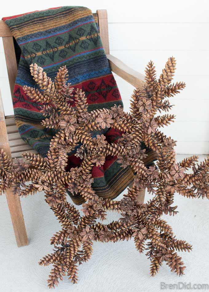 Snowflake Pinecone Wreath on chair