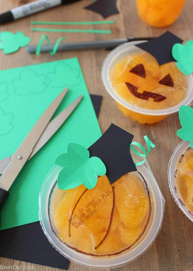 paper and scissors for decorating fruit cups like pumpkins