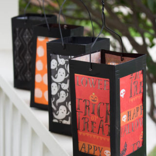 simple milk cartons paper lanterns on porch railing
