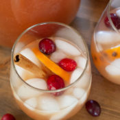 Christmas punch in glass with cinnamon stick