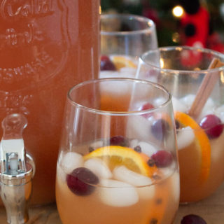 Christmas punch in glasses with dispenser