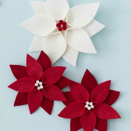 white and red poinsettia felt bows